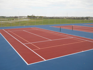 A tennis court repair job in Huxley, Iowa