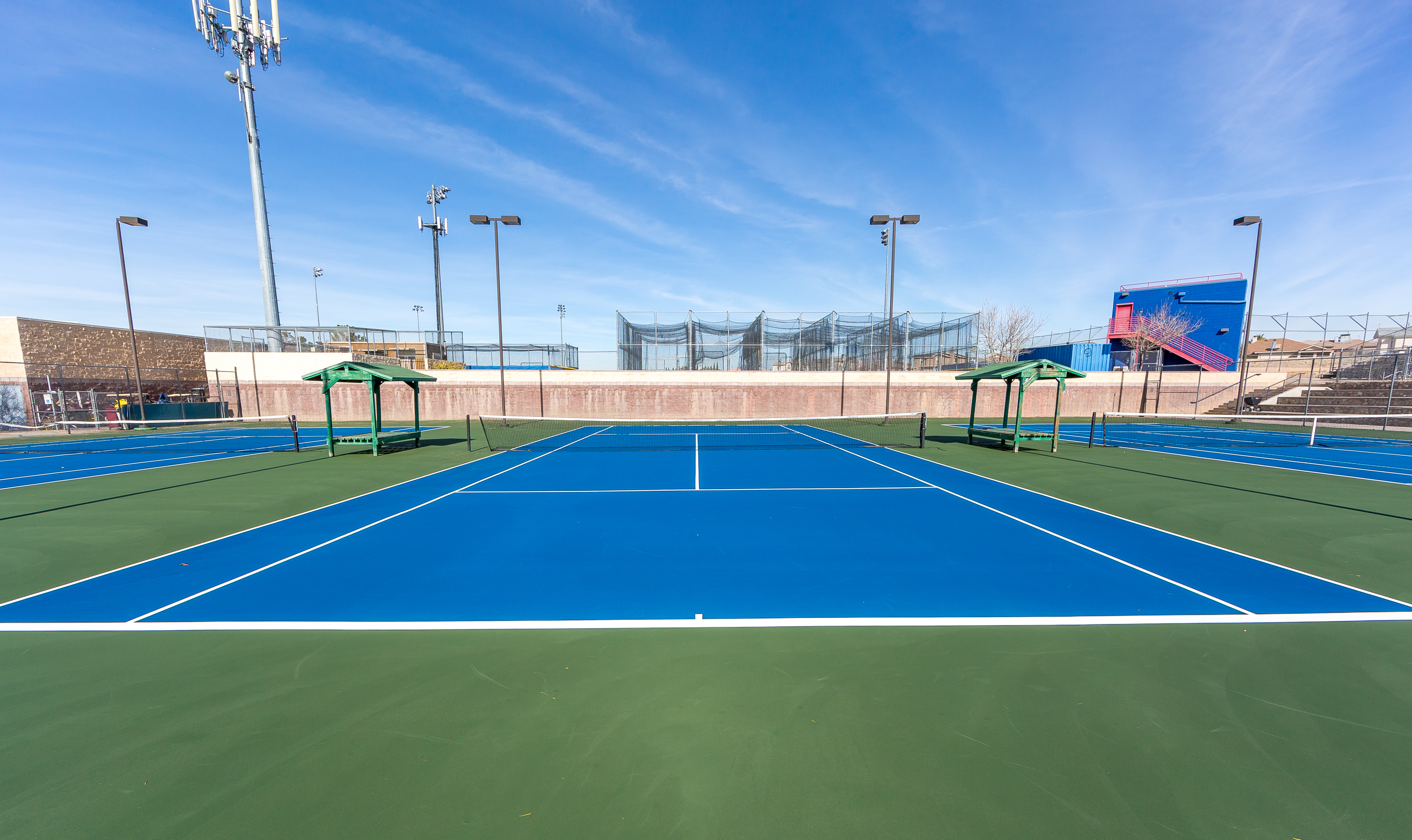 A resurfaced tennis court in blue in El Paso Texas