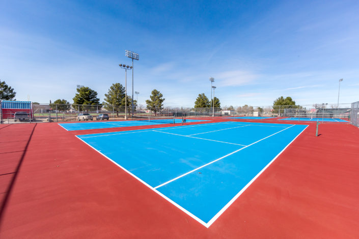 A resurfaced tennis court repaired with Armor Crack Repair in El Paso Texas