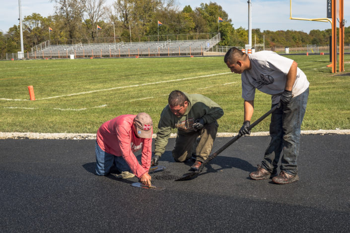 Running Track Repair Experts resurfacing track in Roachdale Indiana