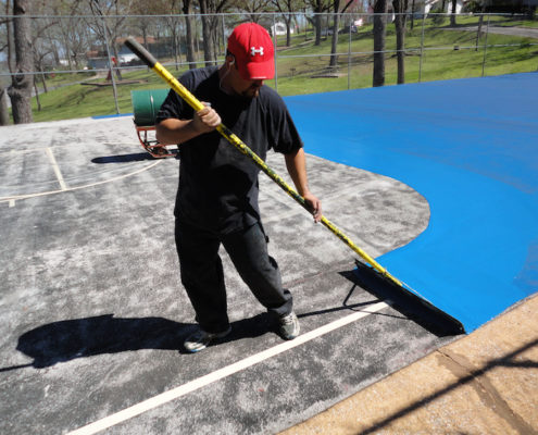 Court Restoration Specialist Resurfacing a Multipurpose Court