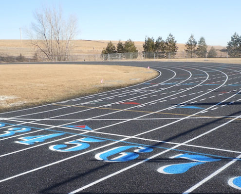 A repaired running track with new lane lines