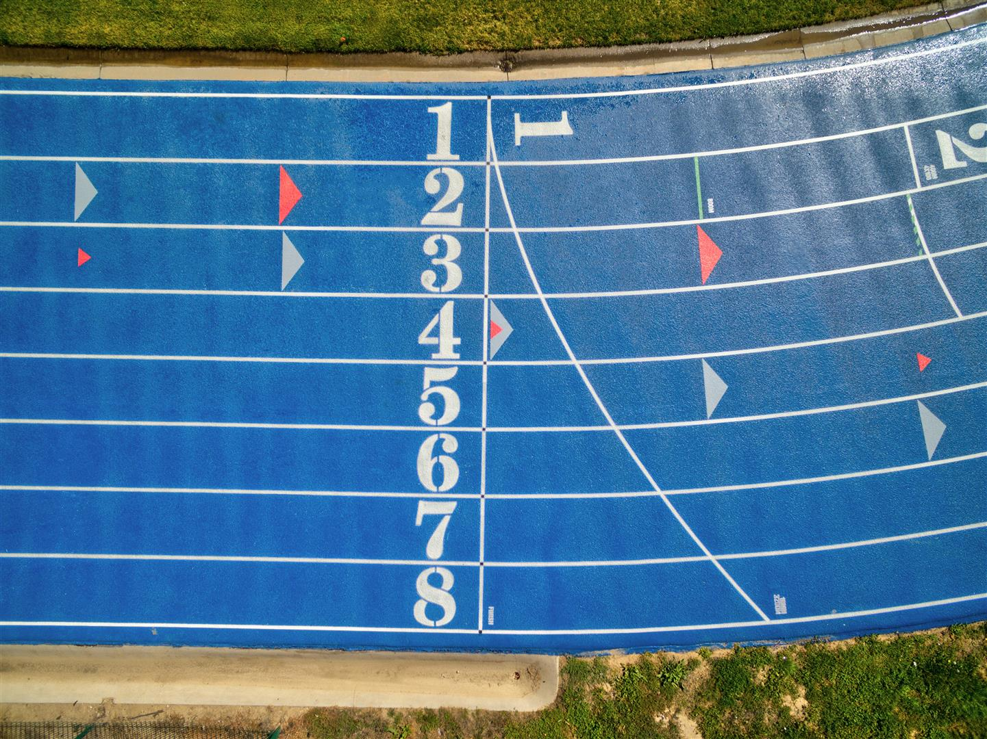 Image of a blue running track surface in Greeley, Colorado