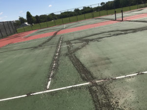 cracked tennis court in Framingham, MN